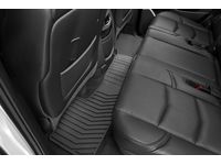 GMC Sierra 3500 HD Second-Row One-Piece Premium All-Weather Floor Mat in Black with Terrain Tire Tread - 22971475