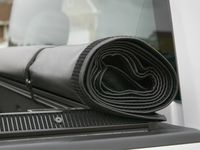 Chevrolet Silverado 3500 Standard Box Soft Roll-Up Tonneau Cover in Black with Bowtie Logo - 22772362